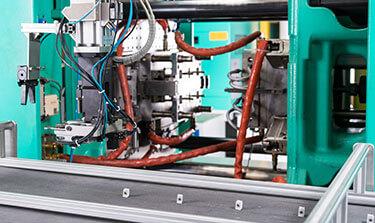 Kunststoff-Spritzguss mit automatisierter Teileablage